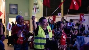 Members of Greenland's opposition Inuit Ataqatigiit party celebrate on election day in the capital Nuuk.
