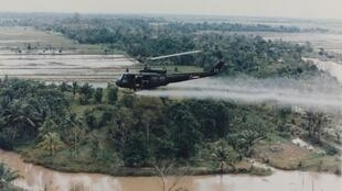 A US helicopter sprays Agent Orange during the Vietnam War.