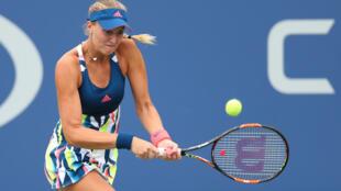 Kristina Mladenovic of France returns a shot against Anastasia Pavlyuchenkova of Russia at the US open.