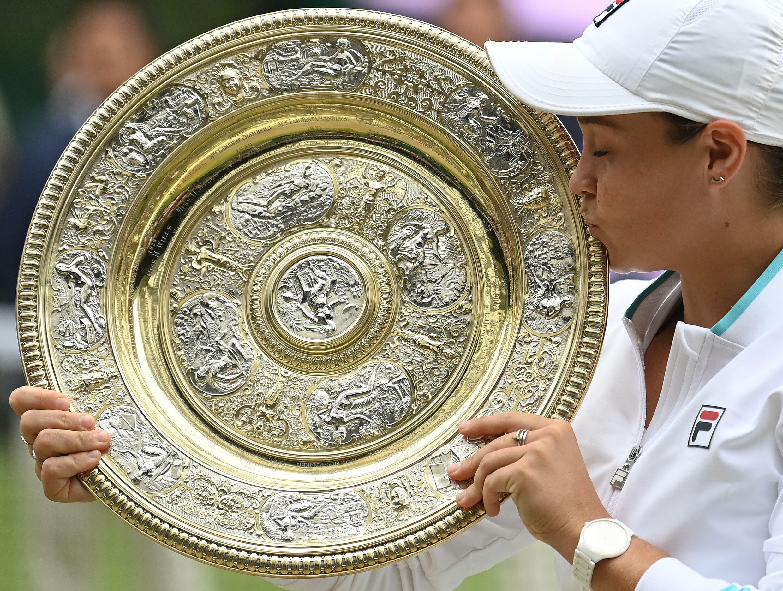 Champion: Australia's Ashleigh Barty kisses the winner's Venus Rosewater Dish