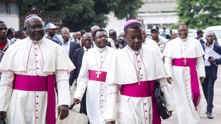 Catholic bishops arrive for a meeting to sign a political agreement between the government and opposition in Kinshasa on 1 January 2017.