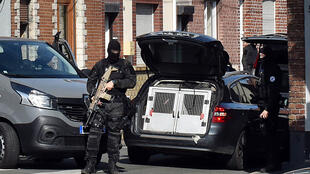 Police raid a house in Wattignies, near Lille, on Wednesday