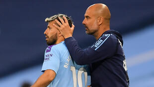 Pep Guardiola (right) is counting on Sergio Aguero's (left)return to help ease Manchester City's goal drought