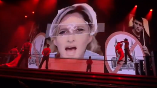 Marine Le Pen's eyes with a swastika shown during Madonna's concert