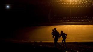 Undocumented migrants cross the Rio Grande river from the Mexican border city of Ciudad Juarez to El Paso, Texas