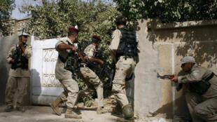 Des membres des brigades sunnites du Sahoua lors d'une opération en 2009.