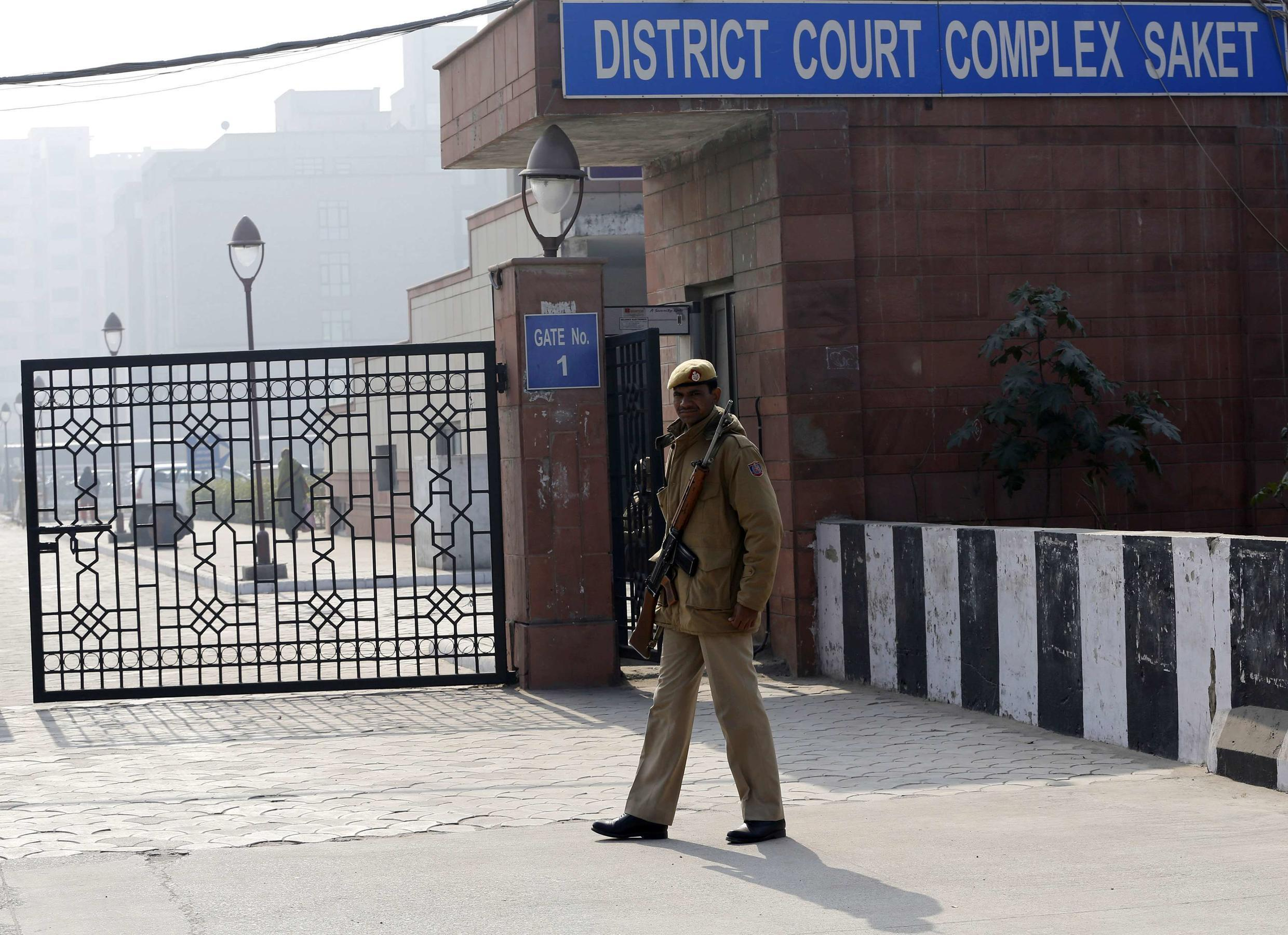 A policeman keeps guard outside a court in New Delhi 7 January, 2013