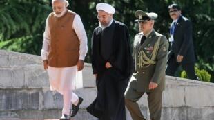 Shugaban kasar Iran Hassan Rohani tare da Firaministan India Narendra Modi.