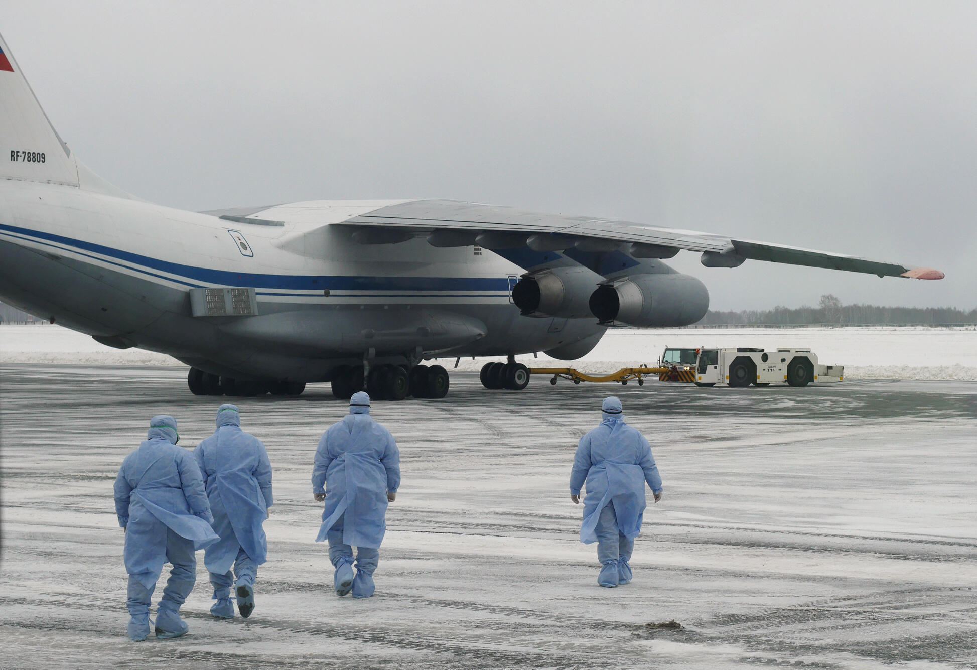 Medical staff members walking towards a military plane, which evacuated citizens of Russia and ex-Soviet countries from China's Wuhan province, the epicentre of an outbreak of the coronavirus epidemic, February 5, 2020.