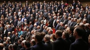 The French parliament observes a minute of silence in tribute to the victims of the Charlie Hebdo attacks