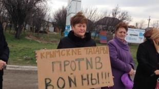 Tatars de Crimée à la veille du référendum sur le rattachement de la région à la Russie en mars 2014.