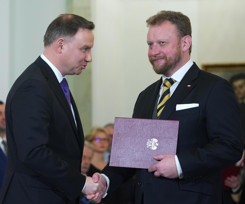 Le président de la République Andrzej Duda (g) et le ministre de la Santé Lukasz Szumowski.