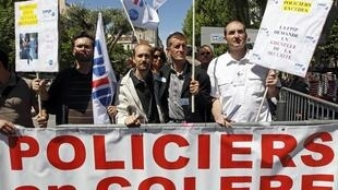 French policemen gather in front of the Police headquarters in Marseille to protest charges laid against a colleague