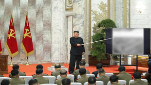 """North Korean leader Kim Jong-Un reappears after an absence of over three weeks. He is seen here presenting a slide in front of members of the  Central Military Commission. The slide is blurred but one of the topics discussed during the meeting was """"nuclear deterrence."""" Picture published 24 May, 2020."""