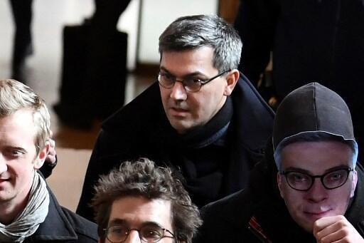 Julien Coupat (centre) arrives at the trial on 13 March