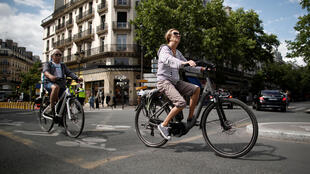 Cyclists ride electric bikes in Paris, which has been expanding its network of bike lanes in the weeks following the end of the confinement imposed to slow the spread of Covid-19.
