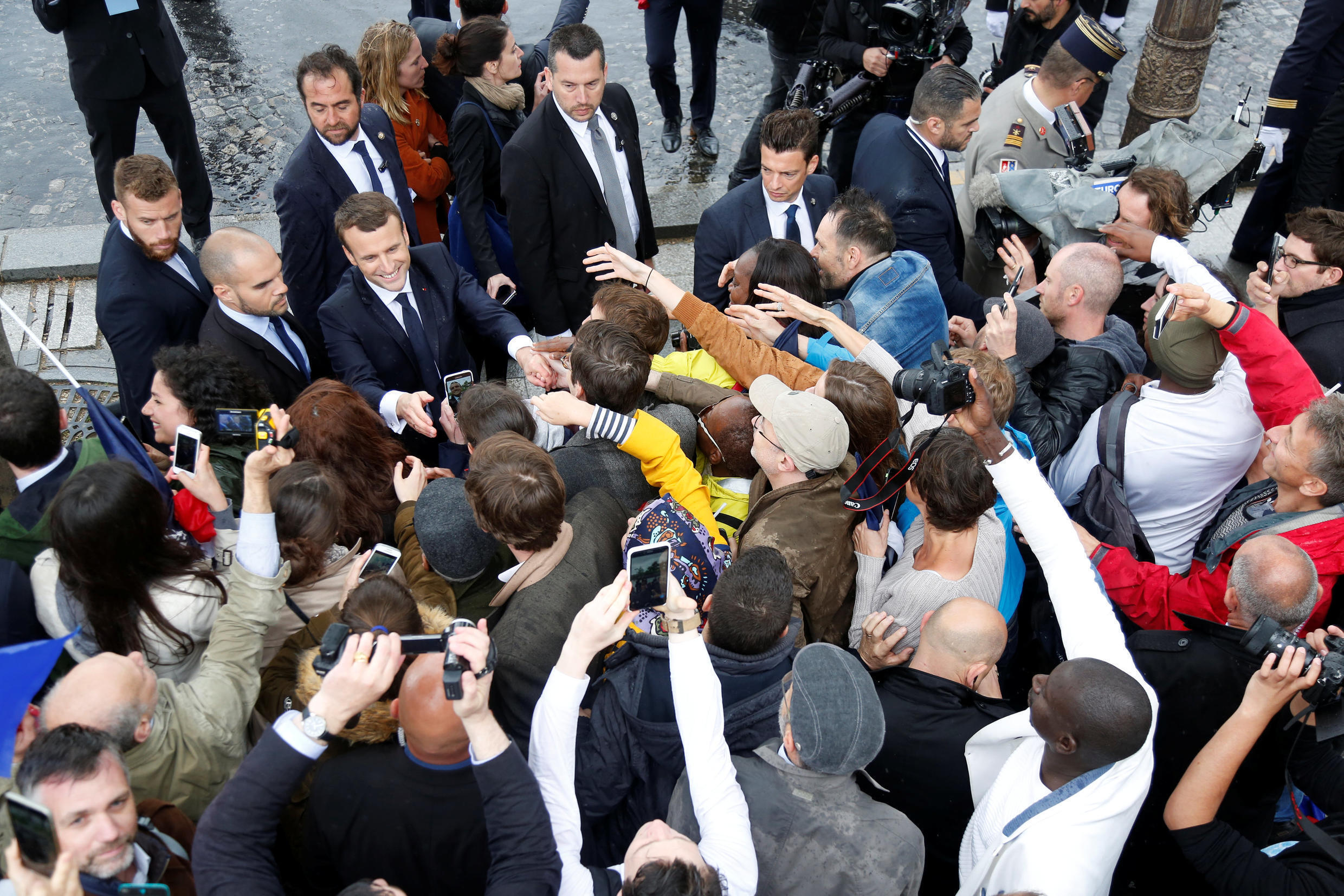 Macron greets the crowd at the Arc de Triomphe