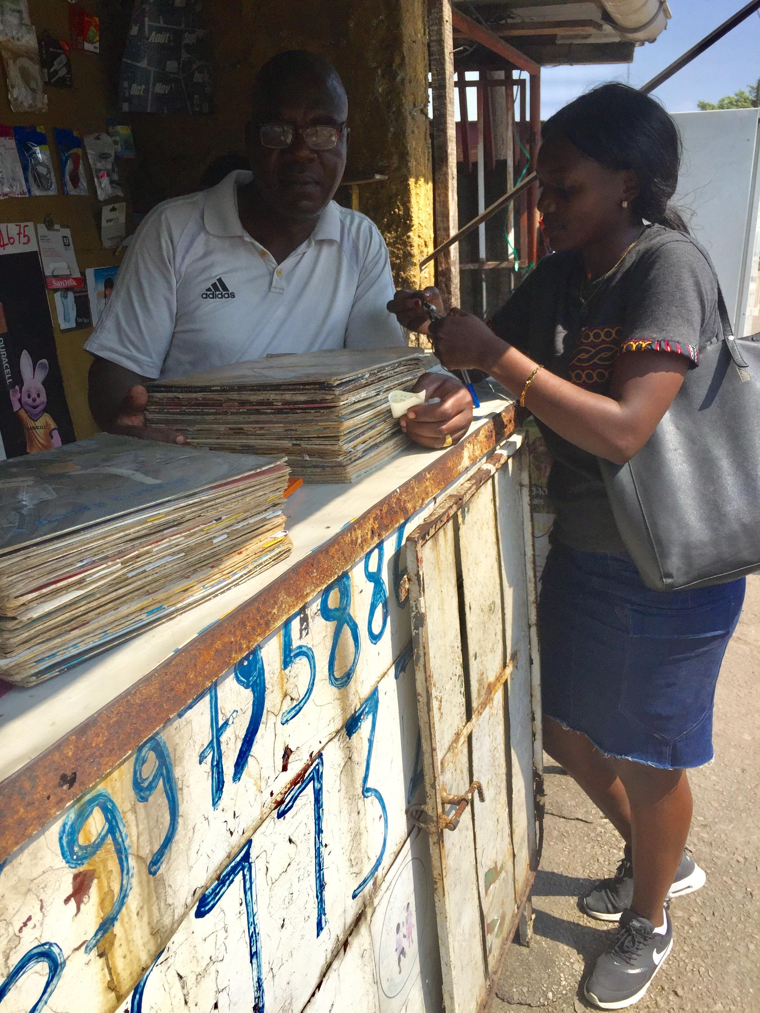Record store owner Valdano (l) with journalist Cynthia Ngwemoh at his vinyl record shop, Valdano in Douala, Cameroon