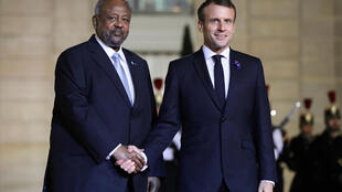 French President Emmanuel Macron greets Djibouti's President Ismail Omar Guelleh prior to a dinner at the Elysee Palace in Paris on 11 November 2019.