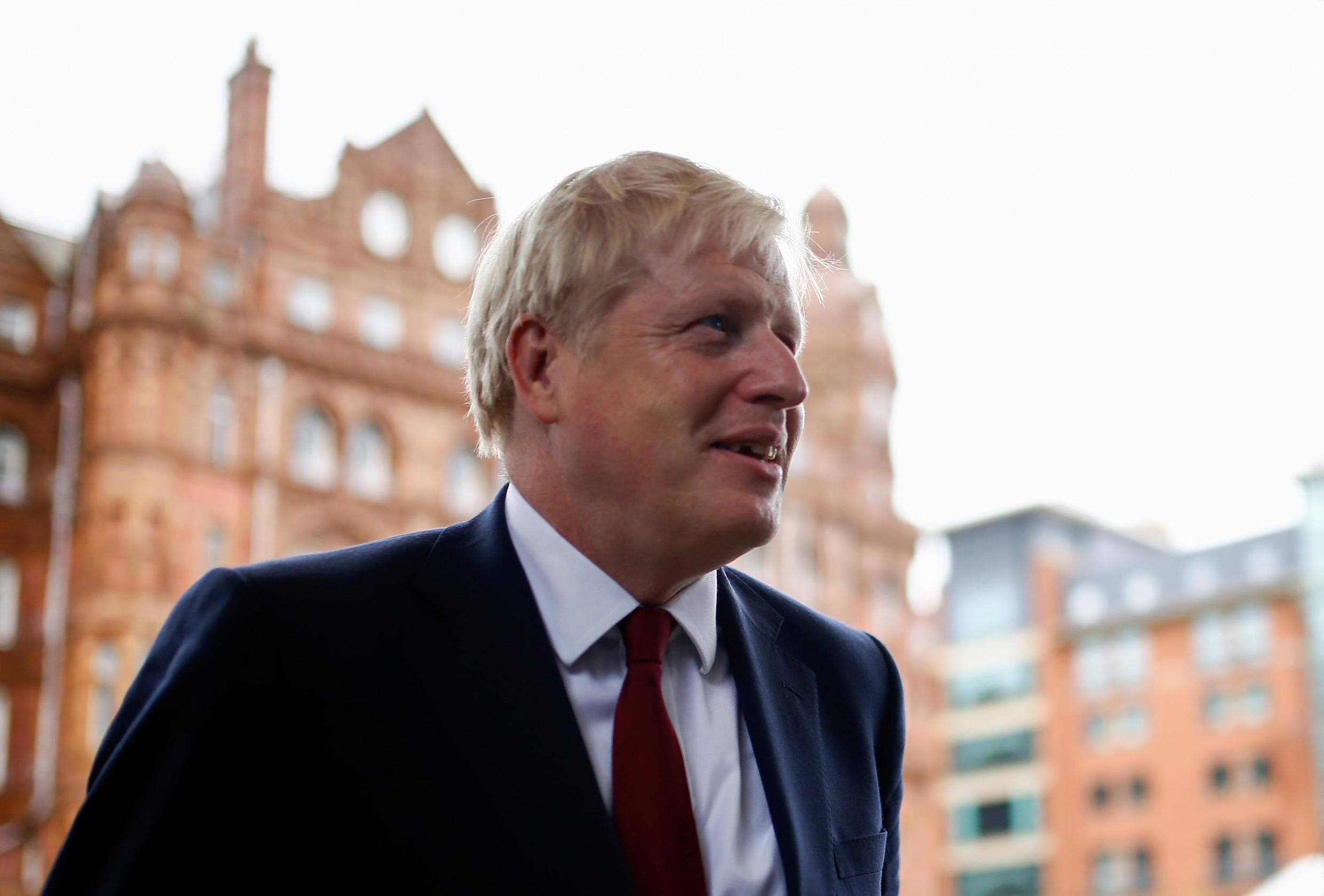Britain's Prime Minister Boris Johnson is seen outside the venue for the Conservative Party annual conference in Manchester, Britain, September 30, 2019.