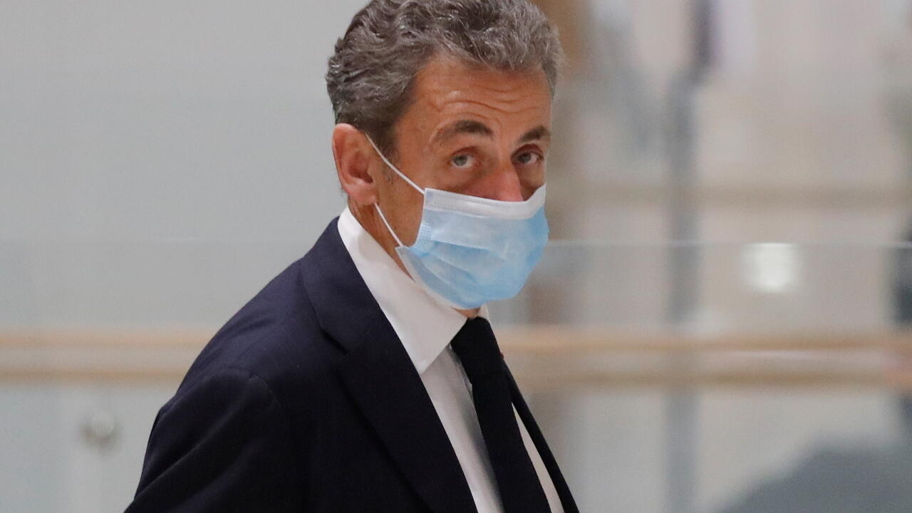 Former president Nicolas Sarkozy leaves court after ...