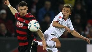 Rafinha (d), do Bayer de Munique, enfrentará o Basel na Suíça.
