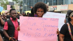 An anti-rape protester on the streets of Monrovia during the three-day demonstrations.