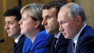 Ukraine's President Volodymyr Zelenskiy, German Chancellor Angela Merkel, French President Emmanuel Macron and Russia's President Vladimir Putin attend a joint news conference after a summit in Paris, 9 December 2019.