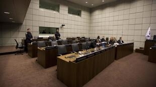 The courtroom lies empty after the defence walked out on 8 February 2011.
