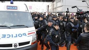 CRS riot police at the Salon de l'agriculture after the agriculture ministry's stand was destroyed on Saturday
