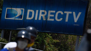 "The DirecTV logo at its headquarters in Caracas on May 19, 2020: US telecoms giant AoT&T has annunced its ""immediate"" withdrawal from the pay television market in Venezuela, where it offered the DirecTV satellite platform, due to the impossibility of complying with legal requirements of both countries."