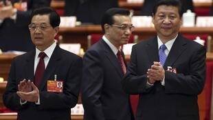China's President Hu Jintao (L) and Communist Party Chief Xi Jinping (R) before the opening ceremony of the NPC, 5 March, 2013