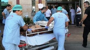 A wounded Syrian man arrives at the Ziv Medical Center in Safed to receive treament.