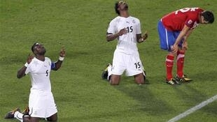 Ghana's John Mensah and Isaac Vorsah celebrate at the end of their match against Serbia