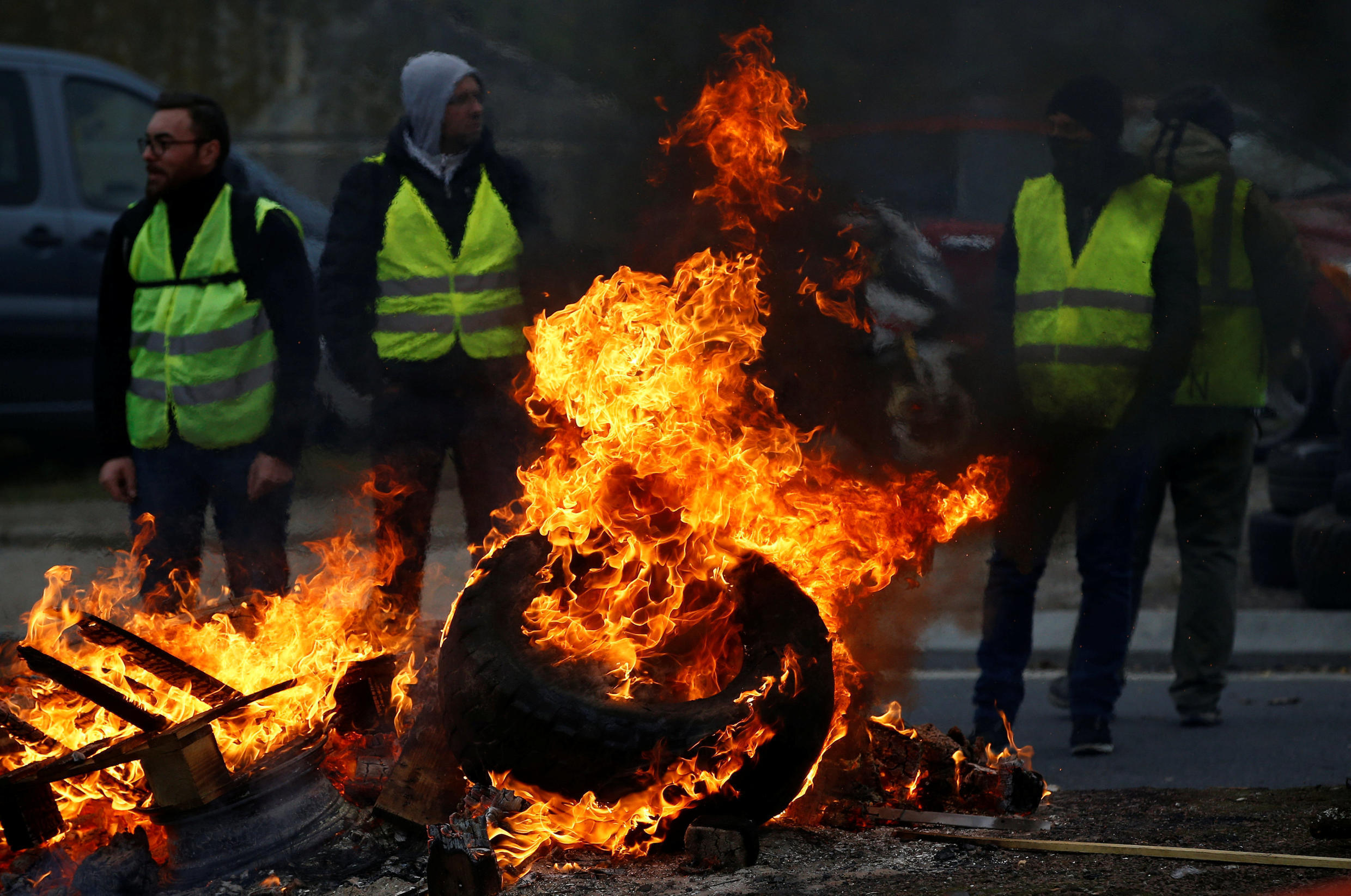 Protesters wearing yellow vests, a symbol of a French drivers' protest against higher fuel prices, attend a demonstration at the entrance of a shopping centre in Nantes, France, November 17, 2018