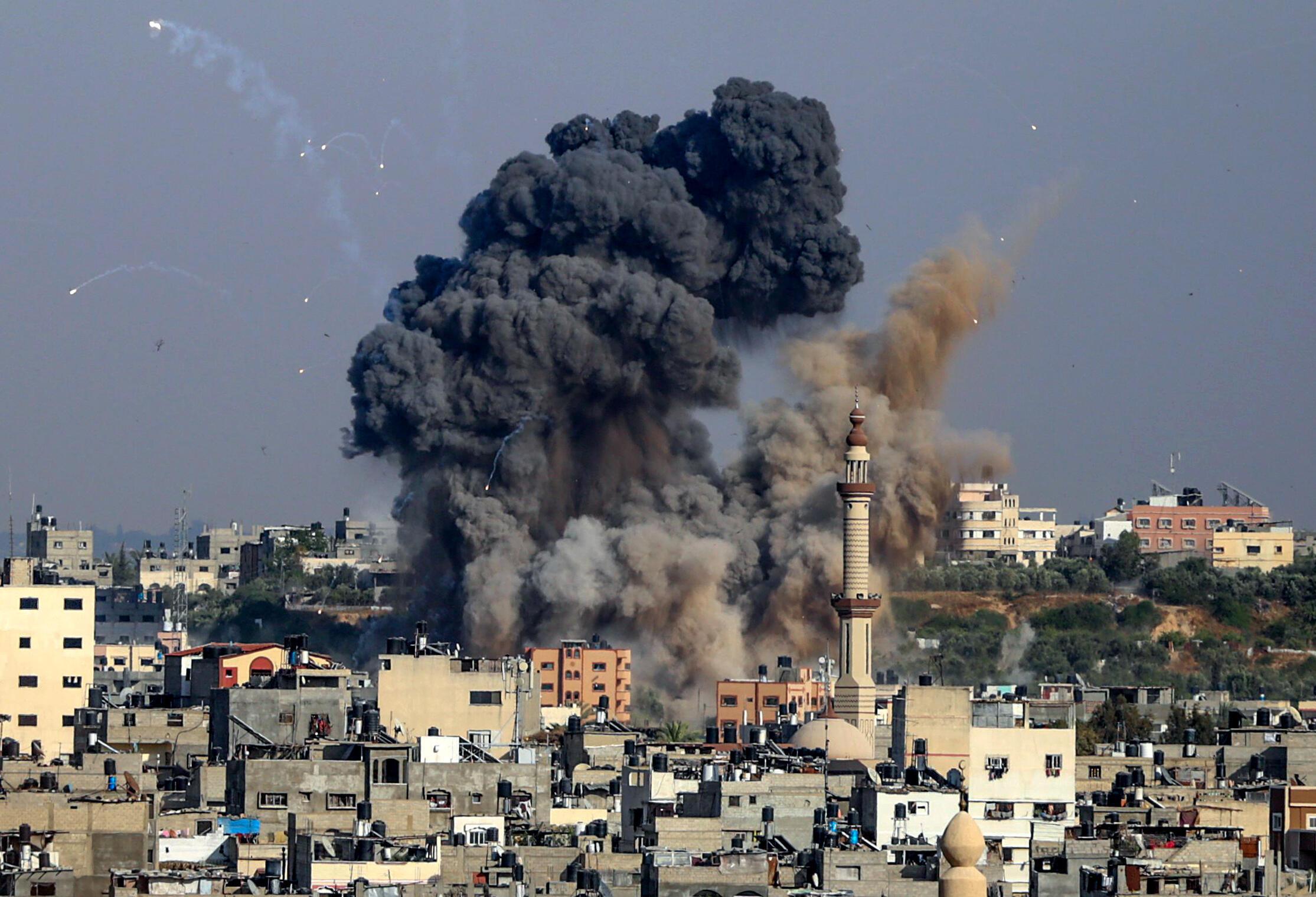 Smoke billows from Israeli air strikes in Gaza City