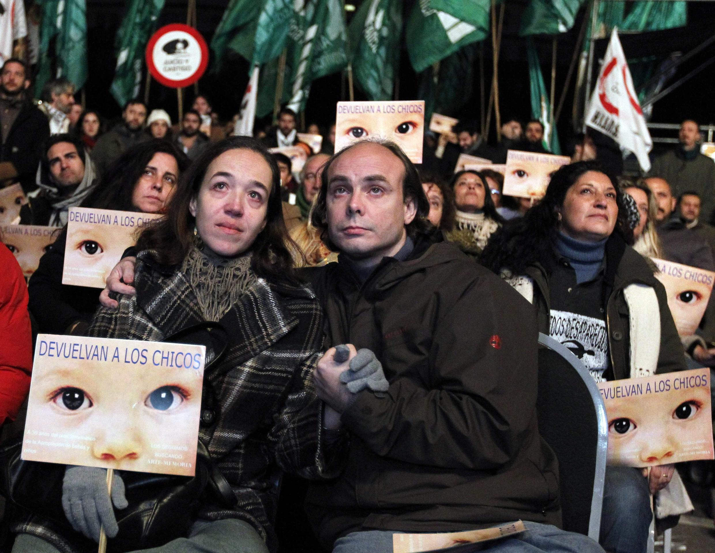 Members of human rights groups react after hearing the verdict in the trial of former Argentine dictator Jorge Videla and other military officers in Buenos Aires, 5 July, 2012