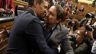 Socialist prime minister Pedro Sanchez with one of his deputies, Pablo Iglesias, the leader of far-left alliance Unidas Podemos, January 2020.