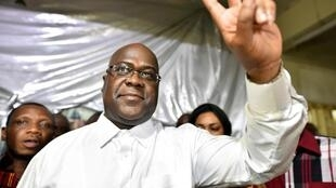 Felix Tshisekedi, leader of the opposition Union for Democracy and Social Progress, gestures to supporters at party headquarters in Kinshasa, Democratic Republic of Congo, 10 January 2019.