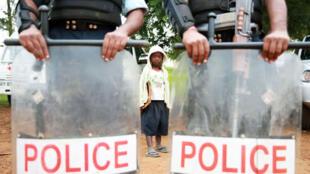 Beni, Nord-Kivu, RDC, le 3 décembre 2014. Des élèments des forces de l'ordre.