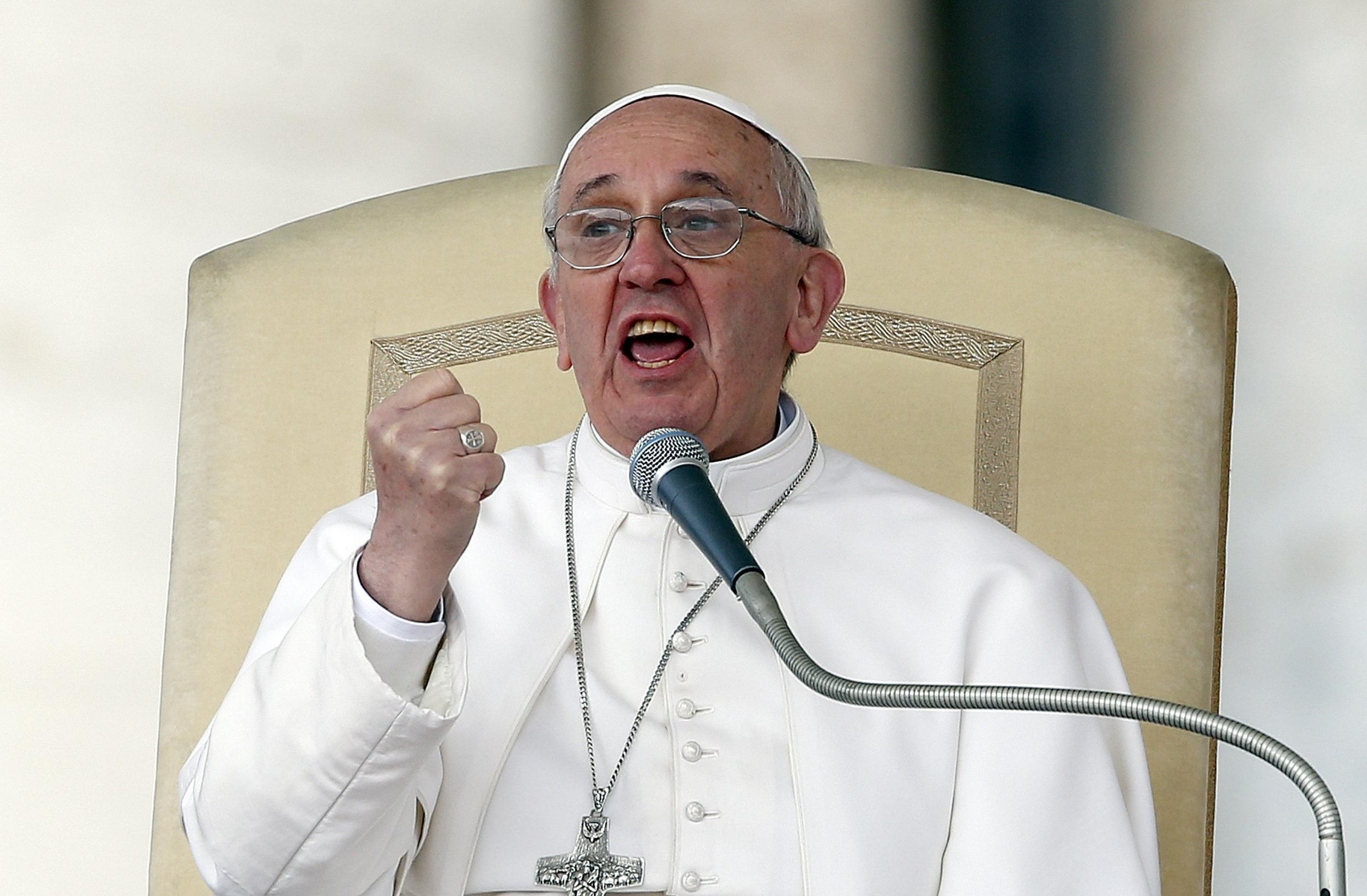 Pope Francis gestures as he speaks during a weekly general audience in Saint Peter's Basilica, at the Vatican April 3, 2013.