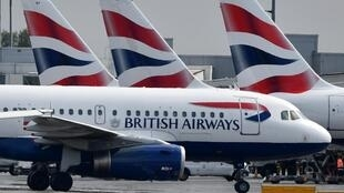 Des avions de la compagnie britannique British Airways à l'aéroport Heathrow, à Londres, le 3 mai 2019.