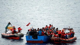 "Migrants are rescued by ""Save the Children"" NGO crew in the Mediterranean sea off Libya coast on 18 June"