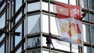French urban climber Alain Robert climbs the Cheung Kong Center building in Hong Kong, China, August 16, 2019. REUTERS/Ann Wang