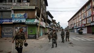 Indian security forces patrol a deserted street during restrictions after the Indian government scrapped special status for Kashmir, in Srinagar August 7, 2019.