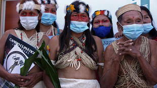 Waorani indigenous women pictured after filing a climate change lawsuit against Chinese oil company PetroOriental in El Coca, Orellana province, Ecuador, on December 10, 2020
