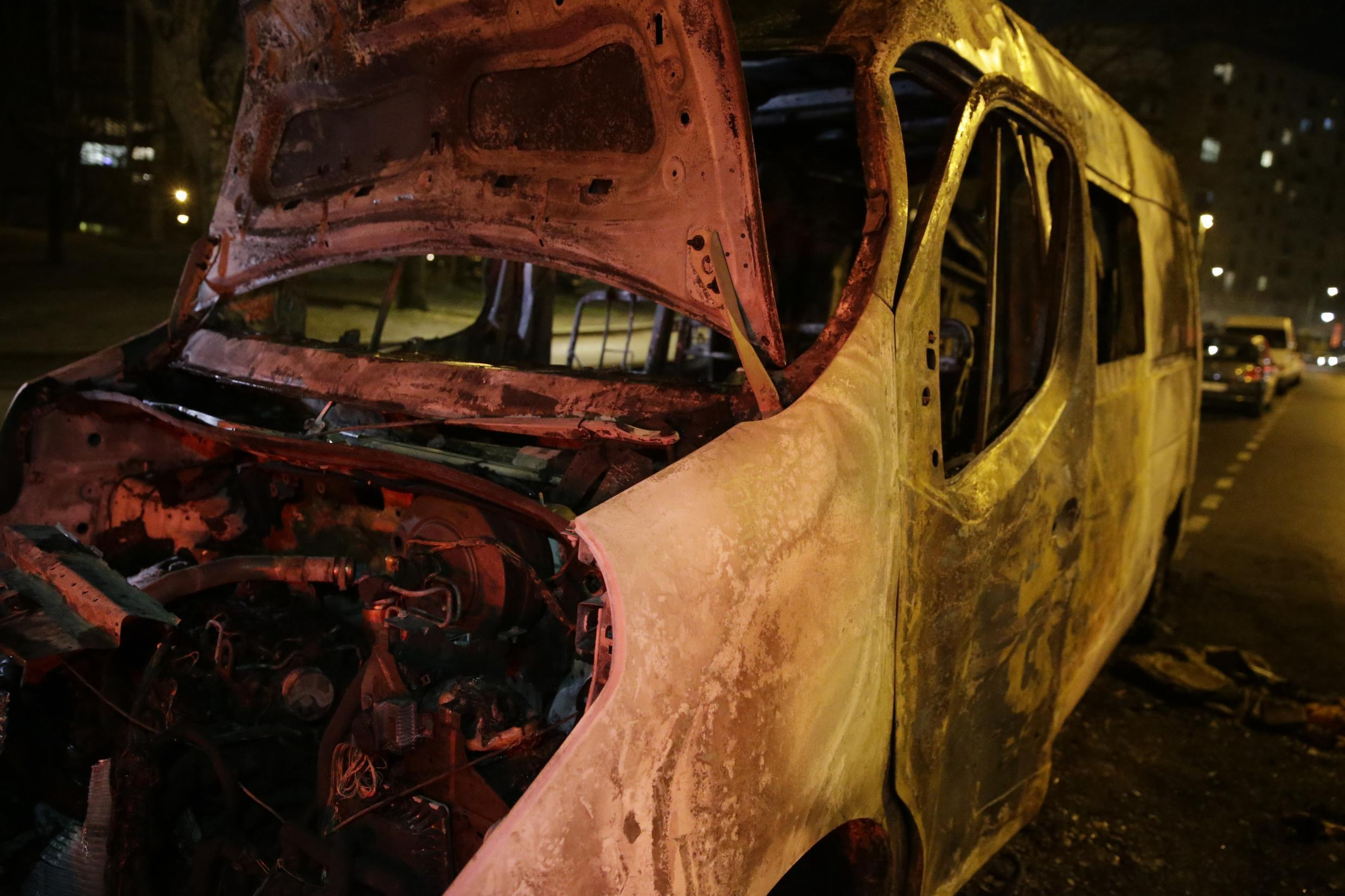 A burnt out van in the Val d'Argent Sud neighbourhood of Argenteuil, after incidents broke out earlier in the evening which led to the arrests of 11 people