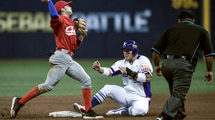 Cesar Prieto (L), considered one of the biggest talents of Cuban baseball, abandoned his team hours after arriving in the United States, where it will seek Olympic qualification
