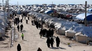 FILE PHOTO: FILE PHOTO: FILE PHOTO: Women walk through al-Hol displacement camp in Hasaka governorate, Syria April 1, 2019.
