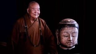 星雲大師和北齊皇族高叡敬造的釋迦尼佛像的佛首